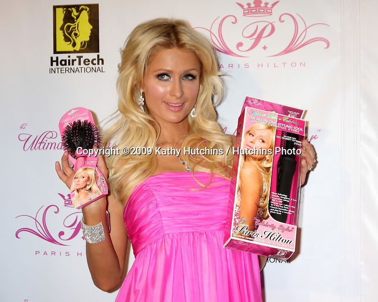 Paris Hilton & new product.arriving at the Paris Hilton Beauty Line Launch Party.Thompson Hotel.Beverly Hills,  CA.November 17, 2009.©2009 Kathy Hutchins / Hutchins Photo.