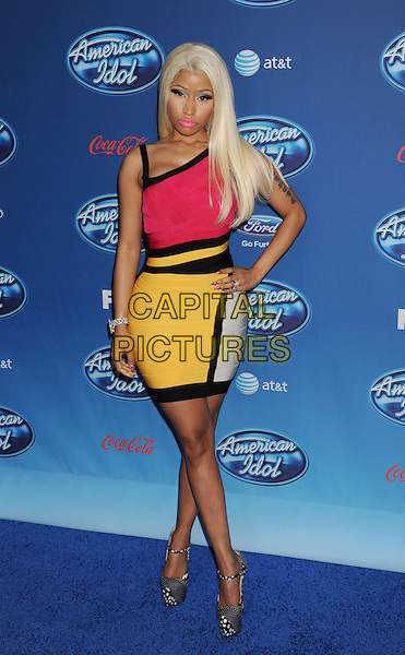 Nicki Minaj.arriving at FOX's American Idol Season 12 Premiere at Royce Hall on the UCLA Campus in Westwood, California, USA, January 9th, 2013..full length red black yellow hand on hip  bandage dress colour block print white black shoes .CAP/ROT/TM.©Tony Michaels/Roth Stock/Capital Pictures