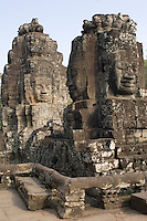 Several of the nearly 200 massive faces carved into the towers and walls of the Bayon, Angkor. This temple, one of the most impressive religious constructions in the world, was started by the Khmer Emperor Jayavarman VII in the early 13th century and some scholars think that the faces are representations of him. Others say that they belong to the boddhisattva of compassion called Avalokitesvara or Lokesvara. At various times in its history, it was a Buddhist and a Hindu temple.
