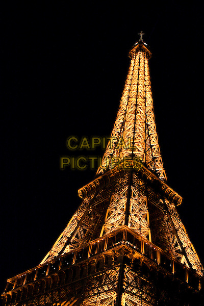 EIFFEL TOWER.Sights of Paris, France..April 2008.atmosphere gv g.v. general view iron Champ de Mars night dark lights illuminated .CAP/SUS.©Davide Susa/Capital Pictures.