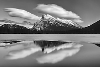 clouds and Mt. Rundle reflected in Vermillion Lakes at sunset<br />