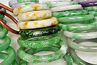 Beautiful jade jewlery in many shapes and sizes is a popular item on display for shoppers in Chinatown. Located amidst the streets of downtown Honolulu.