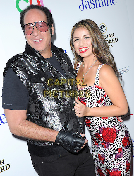 Andrew Dice Clay and Valerie Vasquez<br /> 'Blue Jasmine'  L.A. premiere at The Academy of Motion Pictures Arts and Sciences in Beverly Hills, California, USA.<br /> 24th July 2013 <br /> half length black waistcoat white red floral print dress tinted glasses side married husband wife     <br /> CAP/DVS<br /> &copy;DVS/Capital Pictures
