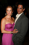 BEVERLY HILLS, CA. - October 02: Poppy Montgomery and Adam Kaufman arrive at Operation Smile's 8th Annual Smile Gala at the Beverly Hilton Hotel on October 2, 2009 in Beverly Hills, California.