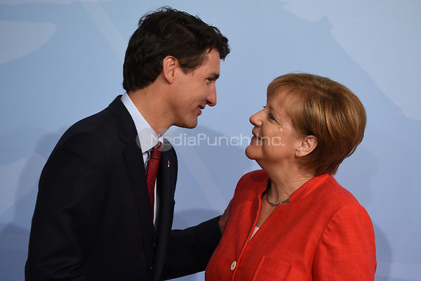 German chancellor Angela Merkel greets the Canadian prime minister Justin Trudeau at the G20 summit in Hamburg, Germany, 7 July 2017. The heads of the governments of the G20 group of countries are meeting in Hamburg on the 7-8 July 2017. Photo: Carsten Rehder/dpa /MediaPunch ***FOR USA ONLY***