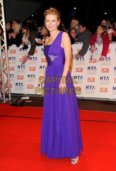 GUEST .At the National Television Awards, held at O2 Arena, London, England, UK, January 20th 2010..arrivals TV NTA full length one shoulder purple long maxi dress .CAP/FIN.©Steve Finn/Capital Pictures.