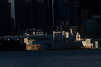 WEST NEW YORK, NJ - APRIL 21: The USNS Comfort navy hospital ship is docked at Pier 90 in Manhattan on April 21, 2020 as seen from West New York, New Jersey . NY Gov. Andrew Cuomo said that New York City no longer needs the Navy ship USNS Comfort to combat the coronavirus pandemic. (Photo by Kena Betancur/ VIEWpress via Getty Images)