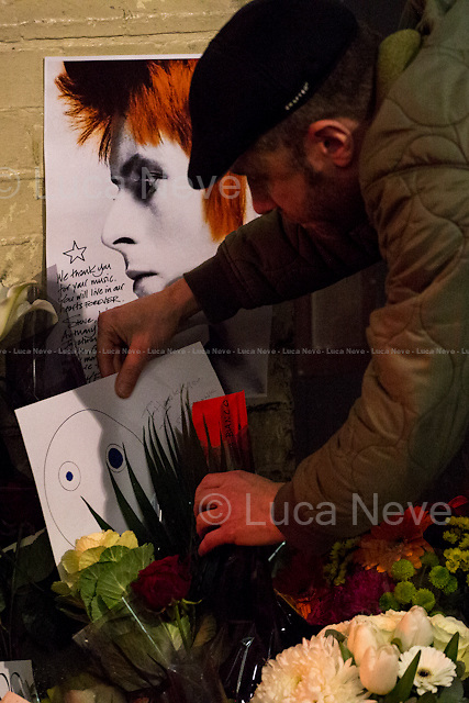 Central London, 23 Heddon Street.<br /> <br /> London, 11/01/2016. Today, David Bowie has died at the age of 69. During the day London's people gathered in Brixton (At Jimmy C graffiti, outside the house at 40 Stansfield Road where he was born, and for the street party outside the Ritzy Cinema) and outside 23 Heddon Street (Where a plaque commemorates Ziggy Stardust) to leave a flower, a message, an album, a candle, a letter; tokens to remember and commemorate a Londoner, an icon and a legend of the world music. David Bowie, real name David Robert Jones (8 January 1947 &ndash; 10 January 2016), was born in Brixton. He was an English singer, songwriter, multi-instrumentalist, record producer, arranger, painter and actor. He died 18 months after being diagnosed with cancer. On the 8th of January, day of his 69th birthday, David Bowie released his 27th and last album: &quot;Blackstar&quot;.<br /> <br /> For more information please click here: http://www.davidbowie.com/