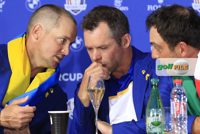 Alex Noran, Paul Casey and Francesco Molinari (Team Europe) at the press conference after Europe win the Ryder Cup 17.5 to 10.5 at the end of Sunday's Singles Matches at the 2018 Ryder Cup 2018, Le Golf National, Ile-de-France, France. 30/09/2018.<br /> Picture Eoin Clarke / Golffile.ie<br /> <br /> All photo usage must carry mandatory copyright credit (© Golffile   Eoin Clarke)