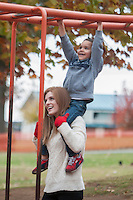 NWA Democrat-Gazette/J.T. WAMPLER  Hope Seitz of Springdale carries her son Braxton while playing Sunday Nov. 15, 2015 at Murphey Park in Springdale. The National Weather Service is calling for rain early this week with low temperatures in the 50s.<br />  For more photos go to nwadg.com/photos