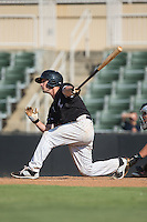 Grant Massey (16) of the Kannapolis Intimidators follows through on his swing against the Greensboro Grasshoppers at Intimidators Stadium on July 17, 2016 in Greensboro, North Carolina.  The Intimidators defeated the Grasshoppers 3-2 in game one of a double-header.  (Brian Westerholt/Four Seam Images)