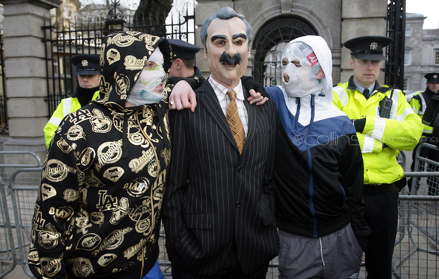"""15/12/2010 Members of The Rubber Bandits (L to r) Blind Boy Boathouse Mr Chrome with a Willie O' Dea Lookalike at the launch of their new single """"Horse Outside"""" which is a song about horses outside Leinster House on Kildare Street , Dublin. Photo: Gareth Chaney Collins"""