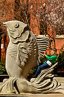 A girl enjoys a warm spring day while visiting The Green in downtown Charlotte, NC. The Green is a 1.5-acre urban park in the heart of Charlotte.
