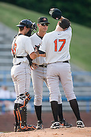 Frederick Keys pitching coach Blaine Beatty (38) chats with starting pitcher Tim Bascom (17) and catcher Justin Johnson (13) at Ernie Shore Field in Winston-Salem, NC, Saturday, June 7, 2008.