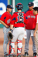 "July 28, 2009:  Starting Pitcher Junichi Tazawa of the Pawtucket Red Sox talks with catcher Dusty Brown, his interpreter, and pitching coach Rich Sauver watch before a game at Coca-Cola Field in Buffalo, NY.  Tazawa was signed out of Japan and making his ""AAA"" debut with Pawtucket, the International League Triple-A affiliate of the Boston Red Sox.  Photo By Mike Janes/Four Seam Images"