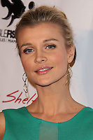 "HOLLYWOOD, CA - JANUARY 14: Model Joanna Krupa arrives at the Los Angeles Screening of Roadside Attractions & Day 28 Films' ""Gimme Shelter"" held at the Egyptian Theatre on January 14, 2014 in Hollywood, California. (Photo by Xavier Collin/Celebrity Monitor)"