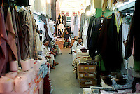 Libyan Arab Jamahiriya   .Tripoli       June 2002. The Medina  Souk Al-Turk .Traditional clothes shop.Libia Tripoli  Giugno 2002.La Medina,   Souk Al-Turk .