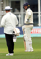 Alex Blake of Kent shares a joke with the match umpire during the friendly game between Kent CCC and Oxford University at the St Lawrence Ground, Canterbury, on Sun Apr 1, 2018