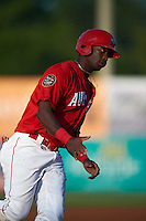 Auburn Doubledays outfielder Randy Encarnacion (19) runs the bases after hitting a home run during a game against the State College Spikes on July 6, 2015 at Falcon Park in Auburn, New York.  State College defeated Auburn 9-7.  (Mike Janes/Four Seam Images)