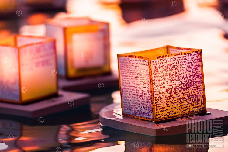 A close-up view on Memorial Day of floating lanterns with candle-lit writing to remember and honor deceased loved ones at the 15th Annual Lantern Floating Ceremony at Ala Moana Beach Park, Honolulu, O'ahu.