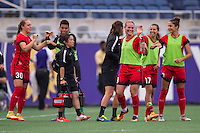Orlando, FL - Sunday June 26, 2016: Celeste Boureille, Tobin Heath  after a regular season National Women's Soccer League (NWSL) match between the Orlando Pride and the Portland Thorns FC at Camping World Stadium.