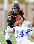 SIOUX FALLS, SD - OCTOBER 16:  Jack Schelhaas #12 from Washington is brought down by Brett Beyer #34 from Rapid City Stevens in the first half of their game Friday night at Howard Wood Field. (Photo by Dave Eggen/Inertia)