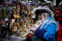 A reveller buys stuff while she attends the annual event Comic Con at the Javits center in New York.  09.05.2014. Eduardo Munoz Alvarez/VIEWpress