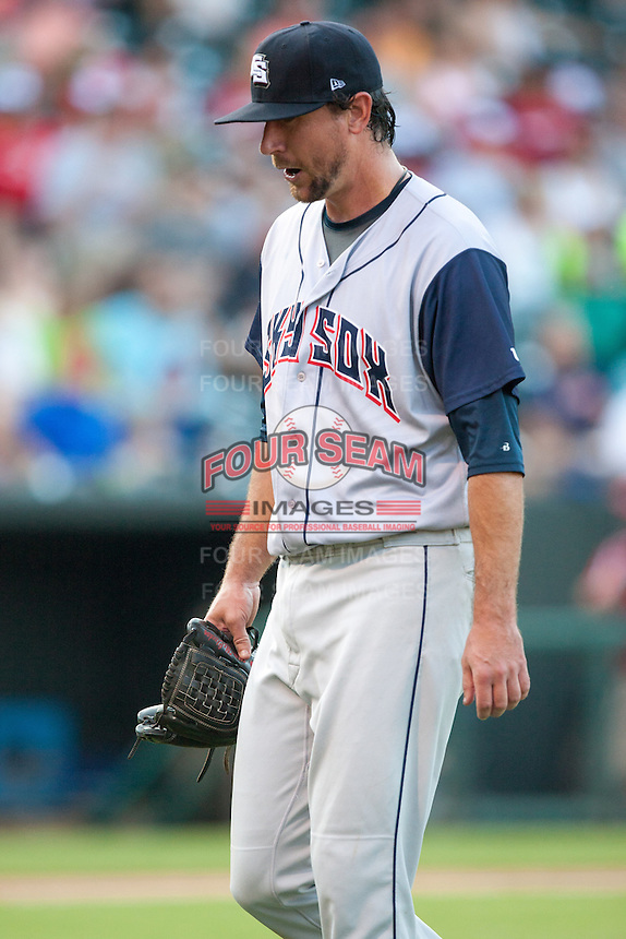 Colorado Springs Sky Sox pitcher Mike McClendon (36) leaves the field after a pitching change during the Pacific League game against the Oklahoma City RedHawks at the Chickasaw Bricktown Ballpark on August 3, 2014 in Oklahoma City, Oklahoma.  The RedHawks defeated the Sky Sox 8-1.  (William Purnell/Four Seam Images)