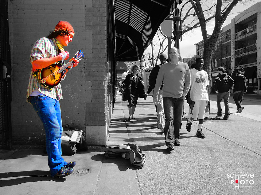 A street musician performs on a warm March day on State Street in Madison, Wisconsin.