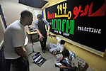 Hip Hop rappers record a jingle for a radio station at the Palestinian refugee camp of Dheisheh, West Bank.