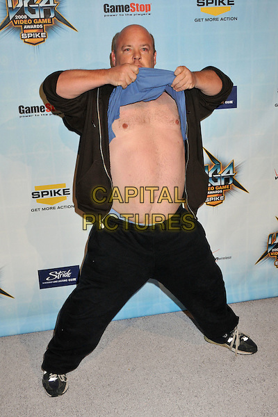 KYLE GASS.Spike TV's 2008 Video Game Awards at Sony Pictures Studios, Culver City, California, USA. .December 14th, 2008.full length black blue hands brown jacket  top jeans denim gesture belly stomach midriff nipples flashing funny.CAP/ADM/BP.©Byron Purvis/AdMedia/Capital Pictures.