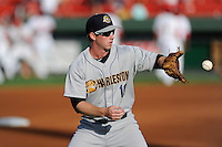 Third baseman Ryan Lindemuth (10) of the Charleston RiverDogs warms up before a game against the Greenville Drive on Sunday, May 24, 2015, at Fluor Field at the West End in Greenville, South Carolina. Charleston won 3-2. (Tom Priddy/Four Seam Images)