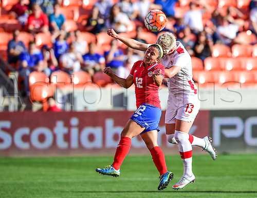 19.02.2016. Houston, TX, USA. Costa Rica Defender Lixy Rodriguez (12) and Canada Midfielder Sophie Schmidt (13) fight for a header during the Women's Olympic qualifying soccer match between Canada and Costa Rica at BBVA Compass Stadium in Houston, Texas.