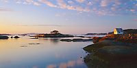 Hancock County, ME<br /> Morning Light on Stonington Harbor's wharfs and fishing boats at low tide, Deer Island