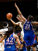 Layshia Clarendon of California passes the ball during the game against Kansas at Haas Pavilion in Berkeley, California on December 21st, 2012.  California defeated Kansas, 88-79.