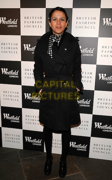 LISA MOORISH.The Westfield Fashion Forward Party Momo bar & restaurant, London, England..January 31st, 2008.full length black jacket trenchcoat coat trench mac hands in pockets .CAP/CAN.©Can Nguyen/Capital Pictures