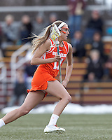 Syracuse University midfielder Amy Cross (11) on the attack.   Syracuse University (orange) defeated Boston College (white), 17-12, on the Newton Campus Lacrosse Field at Boston College, on March 27, 2013.
