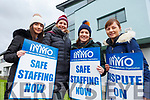 Nurse's Emma Curtin (Ballymac), Ciara Prendiville (Keel), Orla O'Connor (Castleisland) and Julie Cahill (Brosna) at the picket line in day 2 of the INMO dispute at UHK on Tuesday.