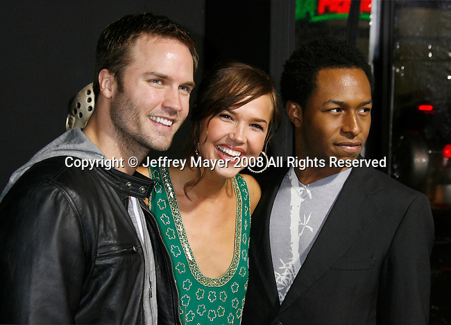 "HOLLYWOOD, CA. - February 09: Actor Scott Porter, Actress Arielle Kebbel and guest arrive at the Los Angeles premiere of ""Friday The 13th"" at Grauman's Chinese Theater on February 9, 2009 in Hollywood, California."