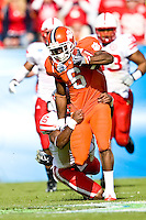 January 1, 2009:   Clemson wide receiver Jacoby Ford (6) tries to avoid the tackle of Nebraska cornerback Armando Murillo (6) during   first half game action in the 64th annual Konica Minolta Gator Bowl between the Nebraska Cornhuskers  and the Clemson Tigers  at Jacksonville Municipal Stadium in Jacksonville, Florida.