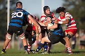 Andrew Jones gets tackled by 3 Karaka defenders. Counties Manukau Premier Club Rugby game between Karaka and Onehwero played at Karaka Sports Park on Saturday May 7th 2016. Karaka won the game 46 - 9 after leading 20 - 9 at half time. Photo by Richard Spranger.