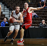 SIOUX FALLS, SD - MARCH 12:  Lucas Huffman #32 from IU East drives baseline past Ben Carlson #42 from Indiana Wesleyan during their semifinal game at the 2018 NAIA DII Men's Basketball Championship at the Sanford Pentagon in Sioux Falls. (Photo by Dave Eggen/Inertia)