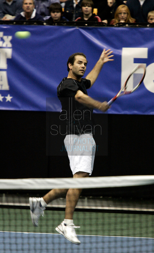 Pete Sampras hits a return during his match against local star Robby Ginepri in the FedEx Shootout Atlanta at Kennesaw State University on Saturday, Dec. 9, 2006.