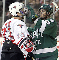 Bemidji State's Radoslav Illo adjusts the facemask of UNO's Eric Olimb during the first period. Illo received a penalty on the play. UNO and Bemidji State skated to a 2-2 tie Friday night at Qwest Center Omaha. (Photo by Michelle Bishop)