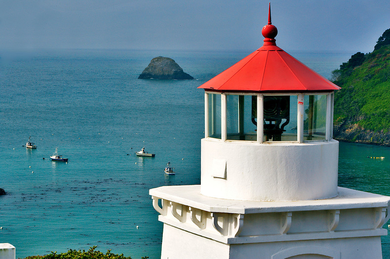 Trinidad Lighthouse with boats in harbor. California