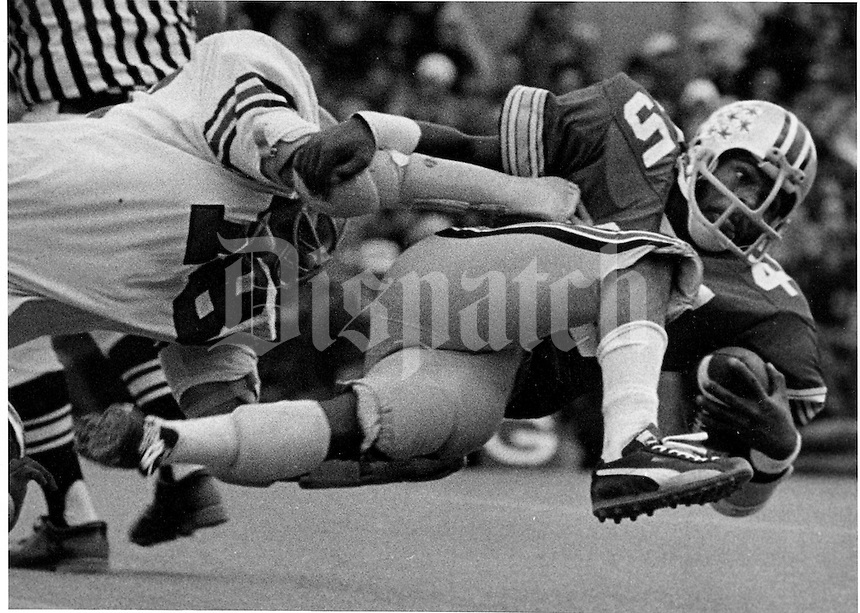 From 1972 to 1975, Archie Griffin graced the OSU Buckeye football program with his determination, strength and courage. Archie earned two Heisman Trophies (1974 and 1975) and to started in four Rose Bowl games.  Archie Griffin is shown here breaking the Big 10 rushing record against Indiana  (Columbus Dispatch photo by Ken Chamberlain 10-19-74)
