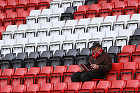 Charlton Athletic fans inspects the official programme during Charlton Athletic vs Middlesbrough, Sky Bet EFL Championship Football at The Valley on 7th March 2020
