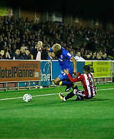 AFC Wimbledon's Lyle Taylor evades Brentford's Ilias Chatzitheodoridis during the Carabao Cup match between AFC Wimbledon and Brentford at the Cherry Red Records Stadium, Kingston, England on 8 August 2017. Photo by Carlton Myrie.