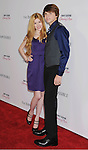 HOLLYWOOD, CA - DECEMBER 10: Katherine McNamara and Joel Courtney arrive at the 'The Impossible' - Los Angeles Premiere at ArcLight Cinemas Cinerama Dome on December 10, 2012 in Hollywood, California.