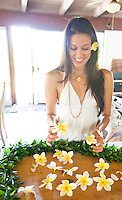 Young Hawaiian woman getting ready to make a plumeria lei